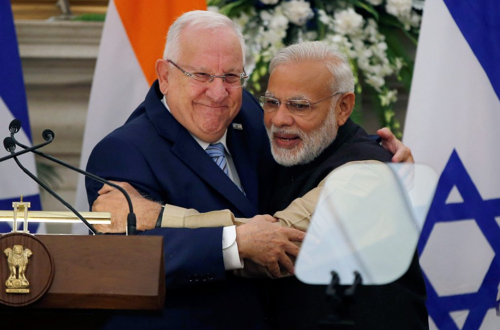 Israeli President Reuven Rivlin and India's Prime Minister Narendra Modi hug each other after reading their joint statement at Hyderabad House in New Delhi, India, Monday. (Reuters/Adnan Abidi)