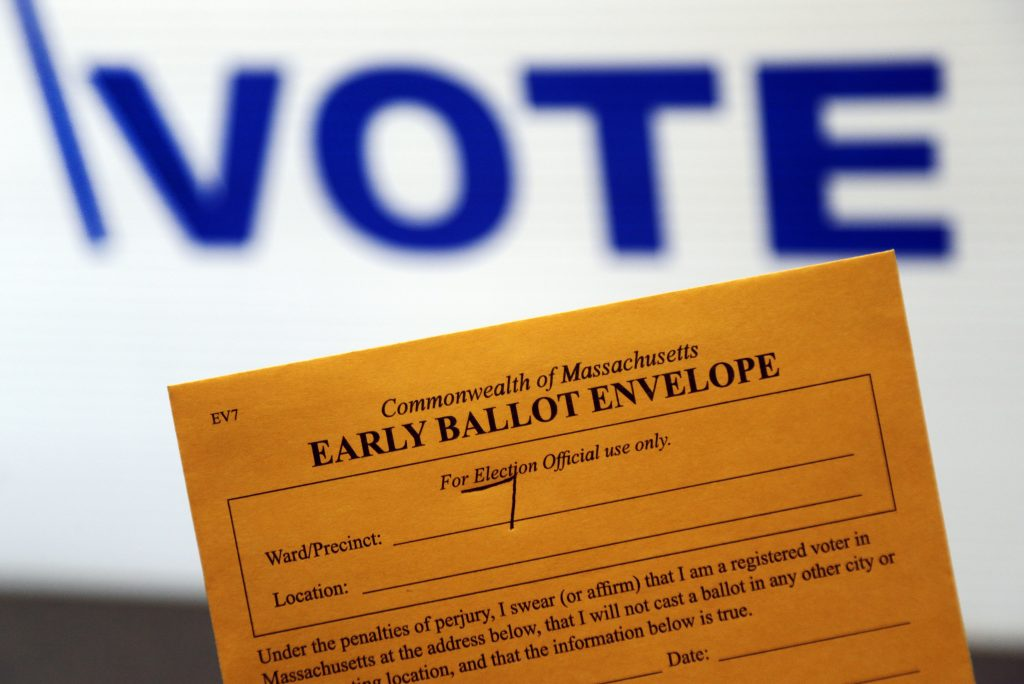 FILE - This Monday, Oct. 24, 2016, file photo, shows an early ballot envelope at town hall, in North Andover, Mass. Some small business owners want to make it easy for their staffers to vote, so they're giving them flex time, balloting breaks, even opening up several hours late to be sure everyone can make it to the polls. (AP Photo/Elise Amendola, File)