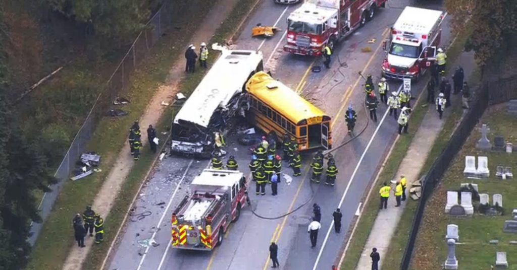 In this frame from video, emergency personnel work at the scene of a fatal school bus and a commuter bus crash in Baltimore, Tuesday, Nov. 1, 2016. (WBAL-TV via AP)