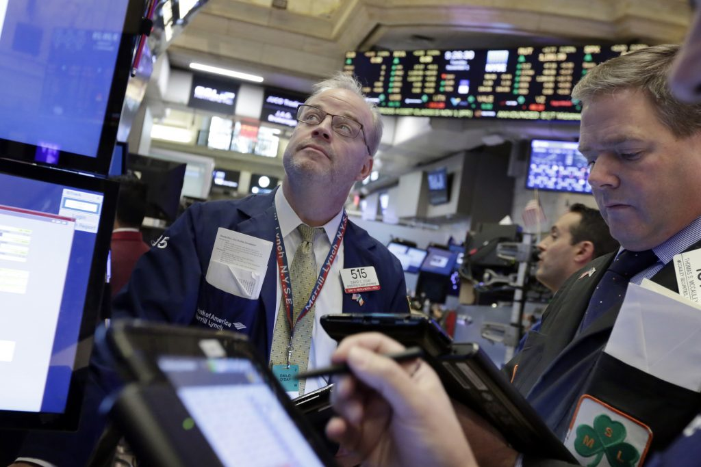 Traders work on the floor of the New York Stock Exchange on Tuesday. (AP Photo/Richard Drew)