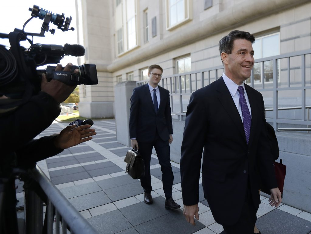 Bill Baroni, right, arrives at the federal courthouse in Newark, N.J., on Friday. (AP Photo/Julio Cortez)