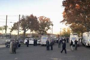 NYPD officers gather at the shooting scene in the Bronx on Friday. (AP Photo/Julio Cortez)