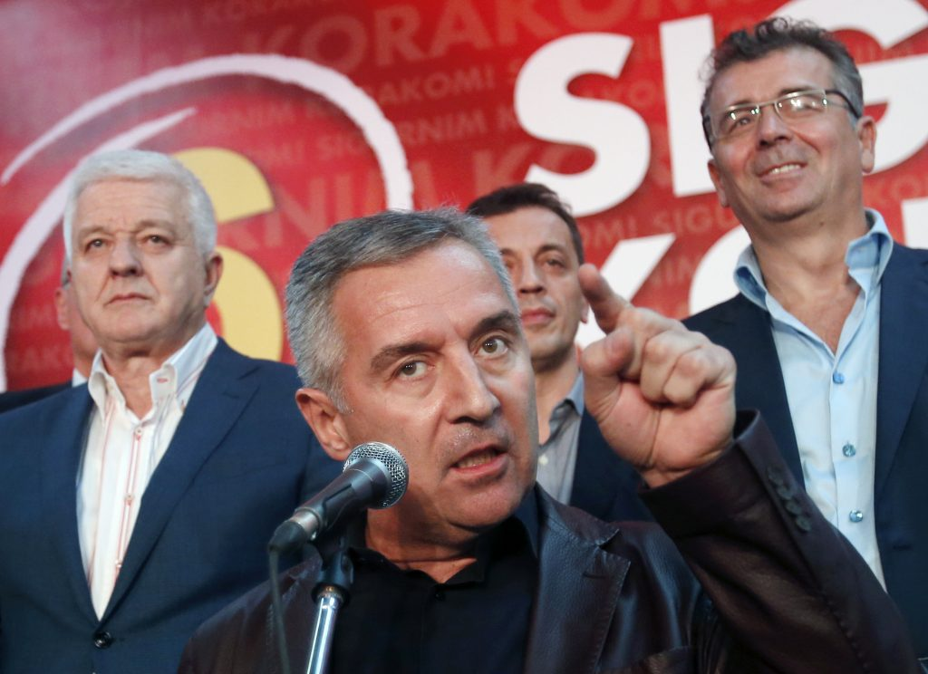 Montenegro's Prime Minister and long-ruling Democratic Party of Socialists leader Milo Djukanovic, center, speaking in his party headquarters, in Podgorica, Montenegro, last month. (AP Photo/Darko Vojinovic, File)