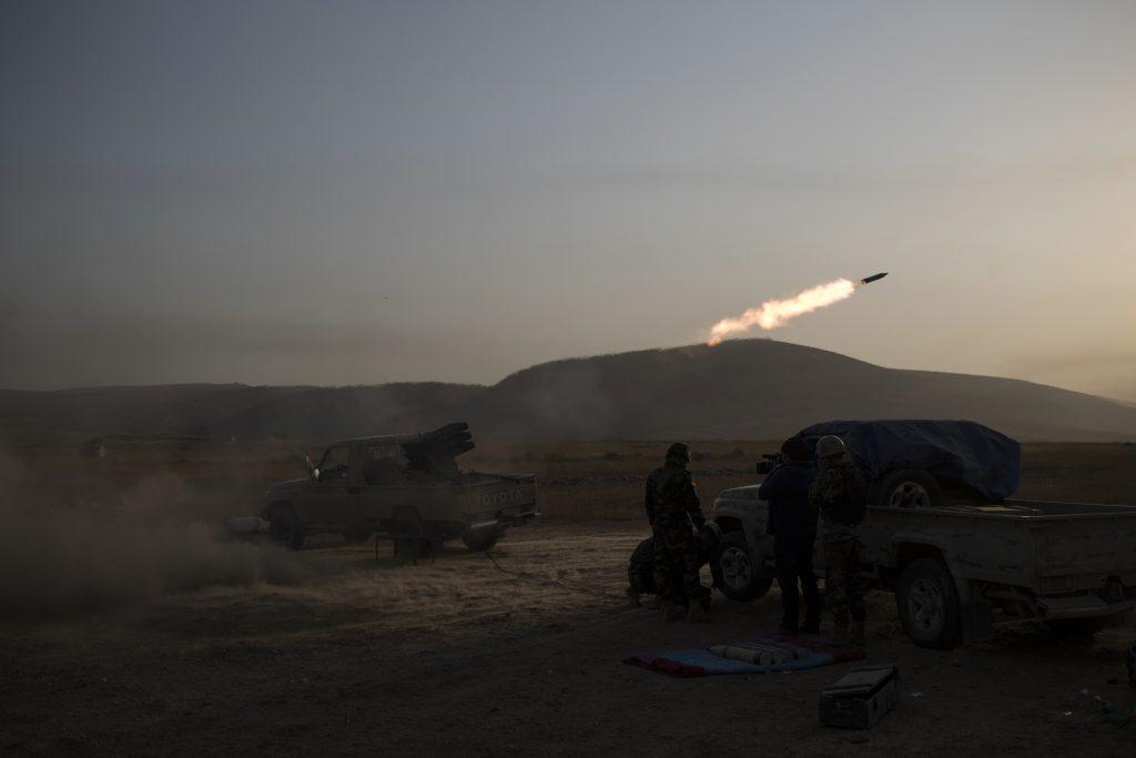 Kurdish Peshmerga soldiers fire artillery at Islamic State positions in Bashiqa, east of Mosul, Iraq, on Monday. (AP Photo/Felipe Dana)