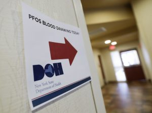 A sign points the way to blood testing for PFOS in Newburgh, N.Y. (AP Photo/Mike Groll)