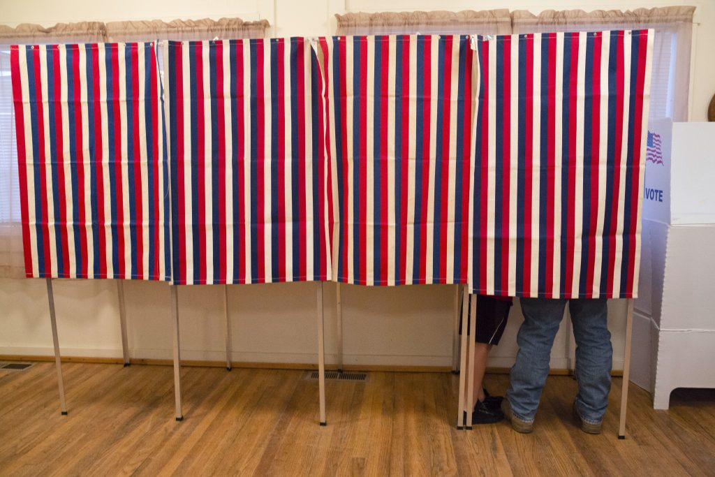 A voter fills out his ballot at the Wilson School House in Wilson, Idaho. (AP Photo/Otto Kitsinger)