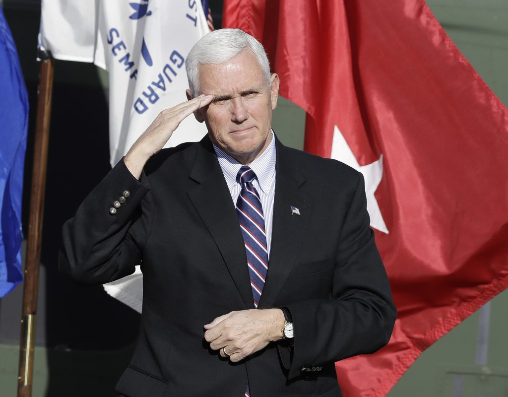 Vice President-elect Mike Pence salutes veterans during a Veterans Day ceremony at Camp Atterbury in Edinburgh, Ind. (AP Photo/Darron Cummings)