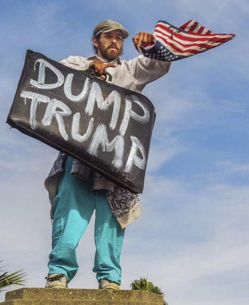 An anti-Trump protester  in downtown Los Angeles on Saturday. (Walt Mancini/The Pasadena Star-News/SCNG via AP)
