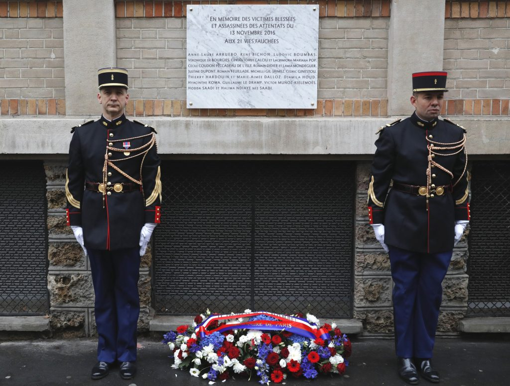"""A commemorative plaque unveiled by French President Francois Hollande and Paris Mayor Anne Hidalgo is seen next to the """"La Belle Equipe"""" bar and restaurant in Paris, France, Sunday, Nov. 13, 2016, during a ceremony held for the victims of last year's Paris attacks which targeted the Bataclan concert hall as well as a series of bars and killed 130 people. (Philippe Wojazer/Pool Photo via AP)"""