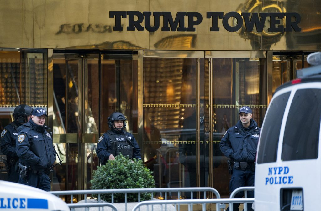 NYPD officers stand guard in front of Trump Tower on Sunday. (AP Photo/Craig Ruttle)
