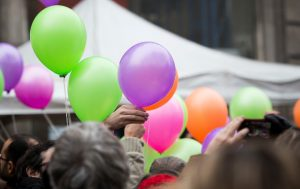 People prepare to release balloons at Paris's 11th district town hall on Sunday. (AP Photo/Kamil Zihnioglu)
