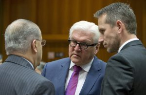 German Foreign Minister Frank-Walter Steinmeier (C) speaks with Cypriot Foreign Minister Ioannis Kasoulides (L) and Danish Foreign Minister Kristian Jensen (R), during a meeting of EU foreign ministers at the EU Council building in Brussels on Monday. (AP Photo/Virginia Mayo)
