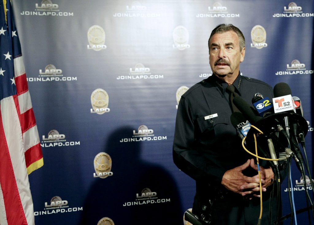 FILE - In this Oct. 4, 2016, file photo, Los Angeles Police Chief Charlie Beck speaks during a news conference in Los Angeles. Beck told the Los Angeles Times on Monday, Nov. 14, 2016, that President-elect Donald Trump's vows to deport millions after taking office will not affect his department's longstanding policy of staying out of immigration issues. (AP Photo/Nick Ut, File)
