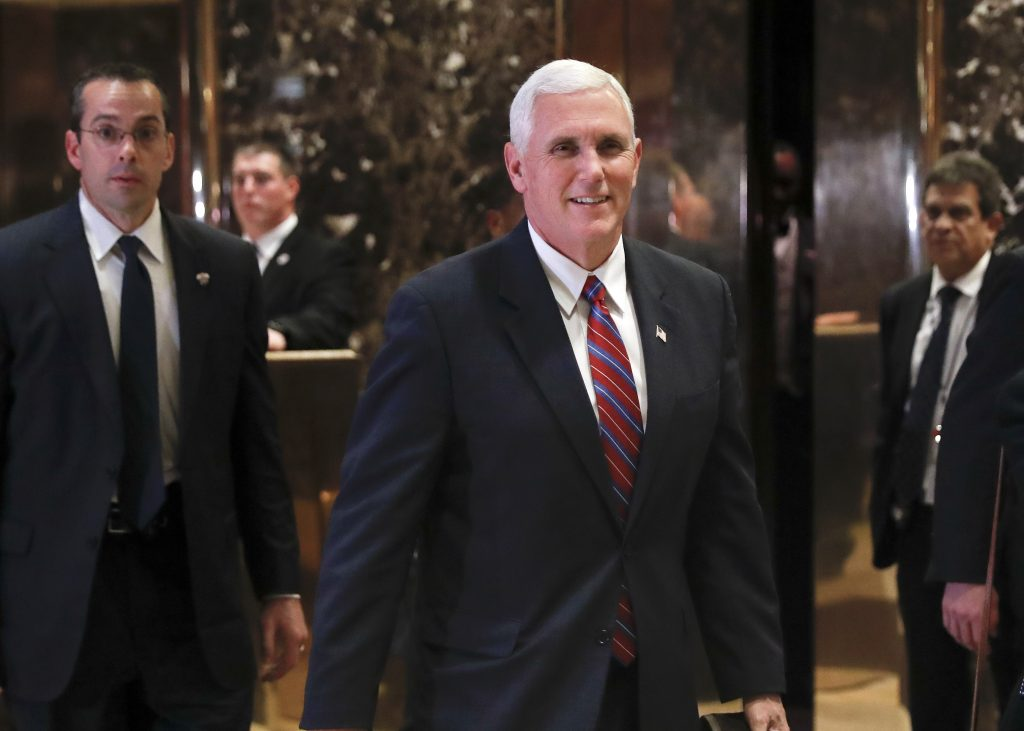 Vice President-elect Mike Pence walks past the media as he leaves Trump Tower, Tuesday, in New York. (AP Photo/Carolyn Kaster)