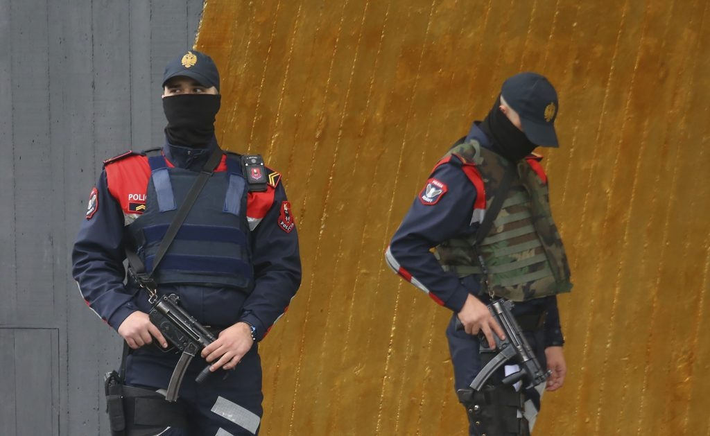 FILE - In this Friday, Nov. 11, 2016 file photo, Albanian special police guard a hotel where the Israeli soccer team are staying, ahead of the World Cup qualifier soccer match against Albania, in downtown Tirana.  Kosovo police said Thursday, Nov. 17, 2016 they prevented simultaneous attacks by the Islamic State group, including on the Israeli national soccer team that played a World Cup qualifier in neighboring Albania. A police statement said plans were in place to attack Saturday's match in Albania, and at the same time attack another target in Kosovo. Nineteen people were detained in Kosovo on Nov. 4, of whom one has since been released, police there said. Albania and Macedonia announced six more people detained. (AP Photo/Hektor Pustina, File)