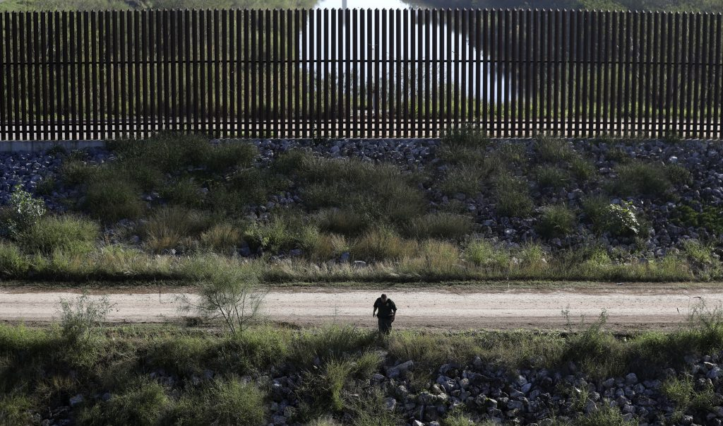 A U.S. Customs and Border Patrol agent searches for suspected illegal immigrants passing through the area in Hidalgo, Texas, last week. (AP Photo/Eric Gay)