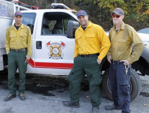 Edward Nieto, Ryan Baca and Christian Mee, firefighters from Albuquerque, N.M., who drove 23 hours to help fight the wildfires near Lake Lure, N.C. (AP Photo/Skip Foreman)