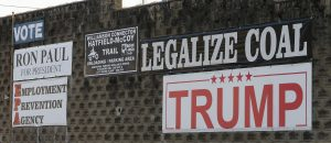Political signs are posted on the wall of a building in Williamson , W.Va. (AP Photo/Steve Helber)