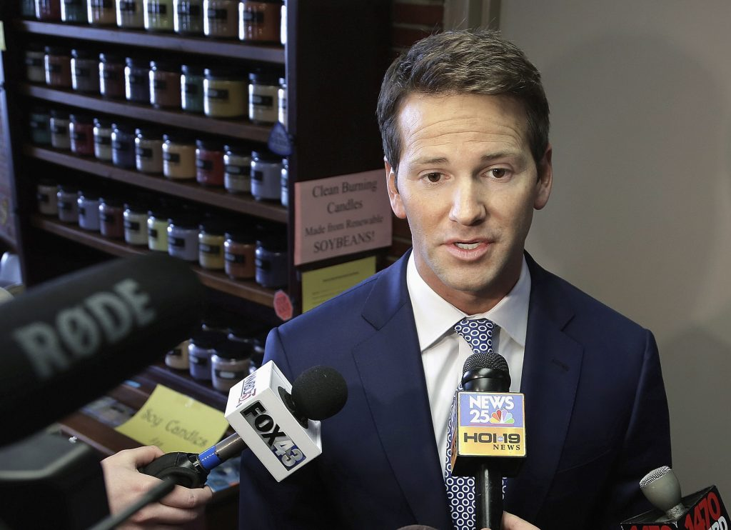 Former U.S. Rep. Aaron Schock, R-Ill. speaking to reporters in Peoria, Ill., last year (AP Photo/Seth Perlman, File)