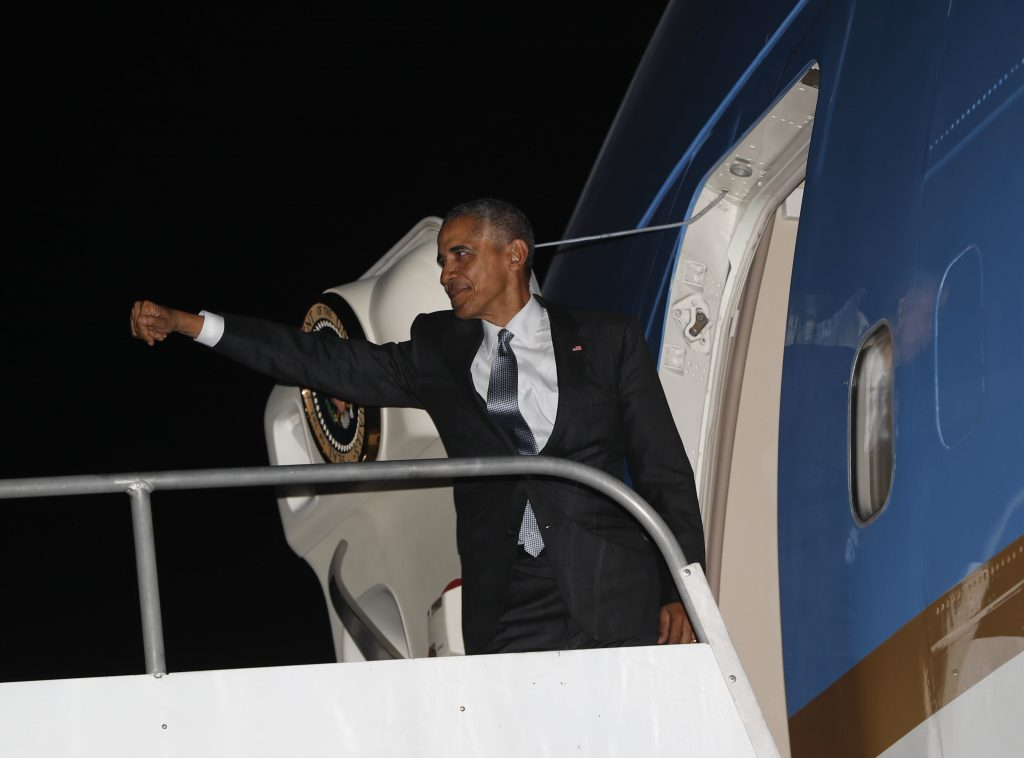President Barack Obama boards Air Force One during his departure at Jorge Chavez International Airport in Lima, Peru, Sunday, Nov. 20, 2016. Obama is heading back to Washington after traveling to South America to attend the annual Asia-Pacific Economic Cooperation (APEC) forum. (AP Photo/Pablo Martinez Monsivais)