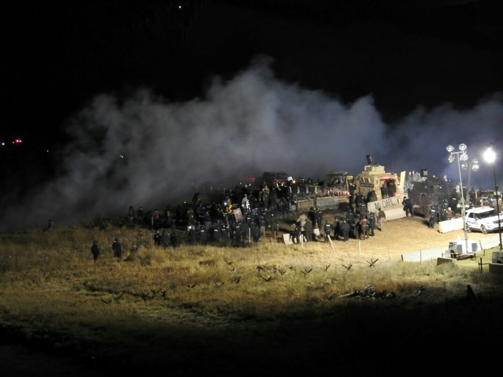 Law-enforcement officers and protesters clash near the site of the Dakota Access pipeline in Cannon Ball, N.D., on Sunday night. (Morton County Sheriff's Department via AP)