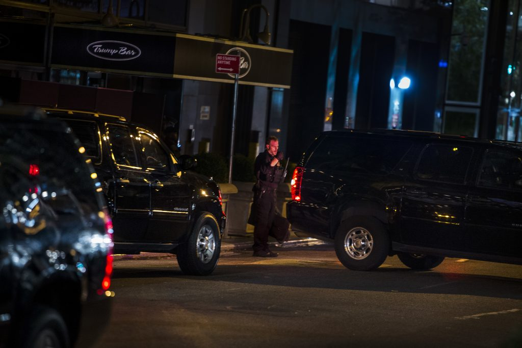 Police park the motorcade that brought President-elect Donald Trump to Trump Tower in New York, Sunday Nov. 20, 2016. (AP Photo/Andres Kudacki)