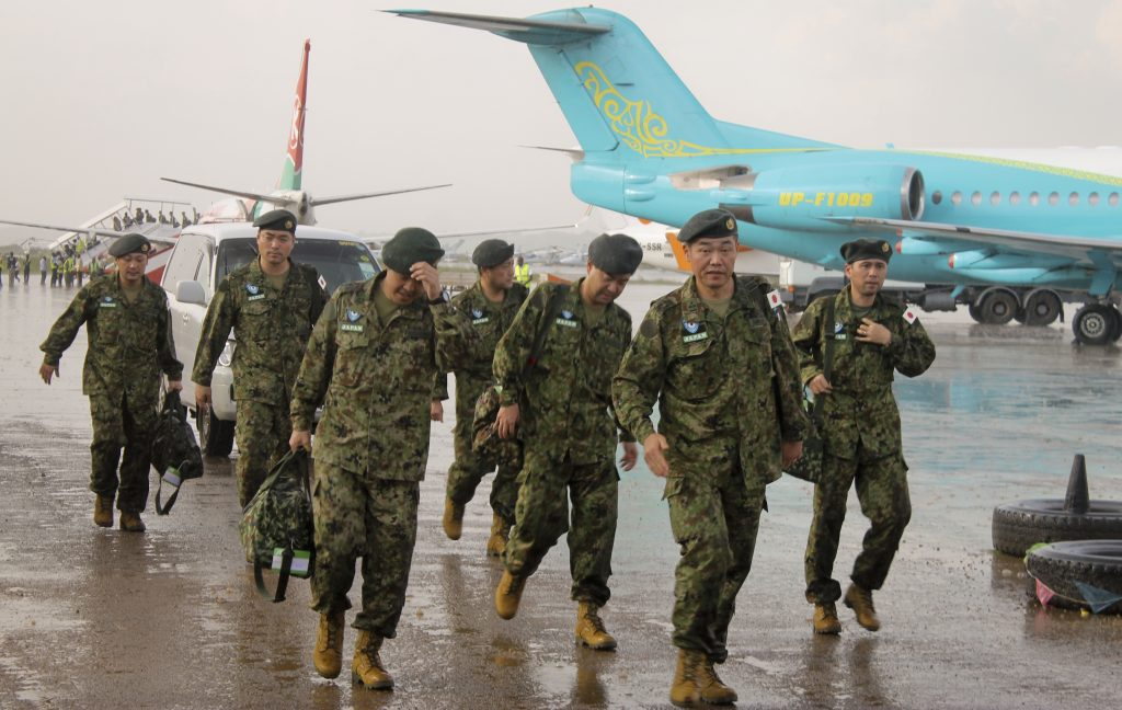 Members of the Japan Self-Defense Forces arrive as in Juba, South Sudan, on Monday. (AP Photo/Justin Lynch)