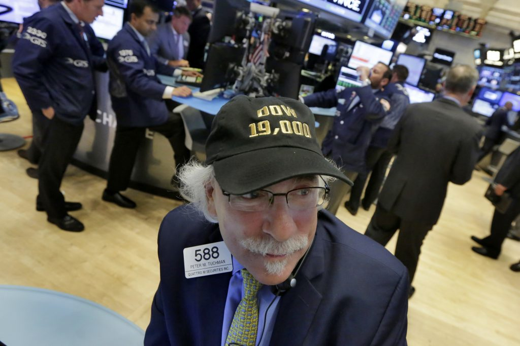 "Trader Peter Tuchman wears his ""Dow 19,000"" cap on the floor of the New York Stock Exchange, Monday, Nov. 21, 2016. U.S. stocks are rising in early trading as the price of oil jumps and energy companies move higher, keeping indexes at record highs. (AP Photo/Richard Drew)"