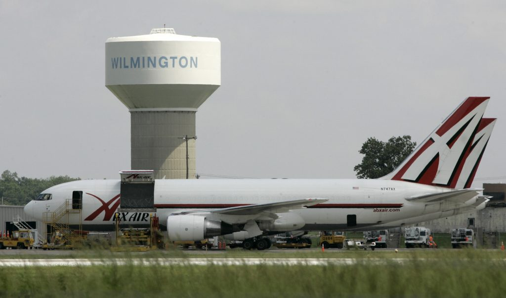 FILE - In this Thursday, June 5, 2008, file photo, two ABX Air cargo planes sit at Wilmington Air Park, in Wilmington, Ohio. Pilots for ABX Air, a cargo airline that carries packages for Amazon and DHL, went on strike Tuesday, Nov. 22, 2016, potentially causing delivery delays just as the holiday shopping season swings into high gear. (AP Photo/Al Behrman, File)