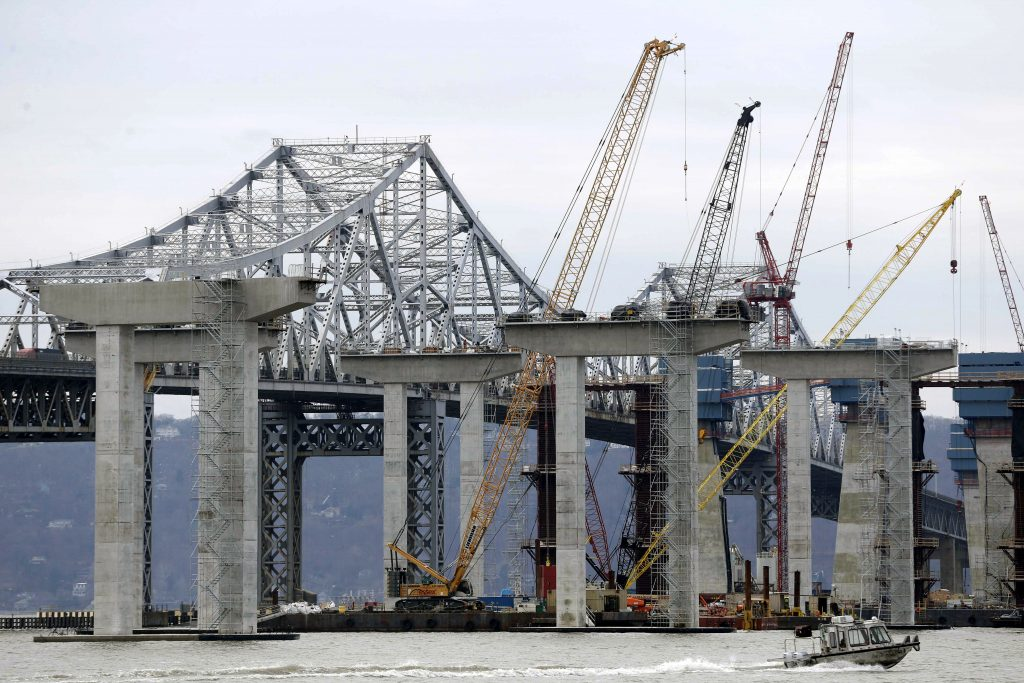 FILE- In this Jan. 14, 2016 file photo, construction continues on the new Tappan Zee Bridge as it is seen from Tarrytown, N.Y. New York Gov. Andrew Cuomo has launched efforts to rebuild Kennedy and LaGuardia airports, remodel and expand Penn Station, and replace the Tappan Zee Bridge. Federal support could be critical to getting the work done, and Cuomo, a Democrat, says he hopes Republican president-elect Donald Trump understands the need to help. (AP Photo/Seth Wenig, File)