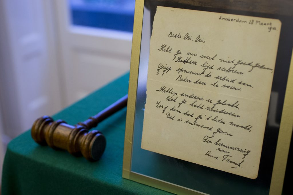 The poem handwritten by Anne Frank is displayed at Bubb Kuyper auction house in Haarlem, Netherlands, on Wednesday. (AP Photo/Peter Dejong)