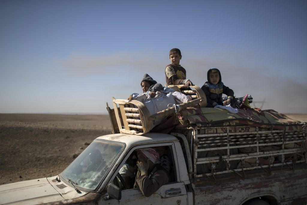Civillians flee fighting between Iraqi forces and Islamic State southeast of Mosul on Wednesday. (AP Photo/Felipe Dana)