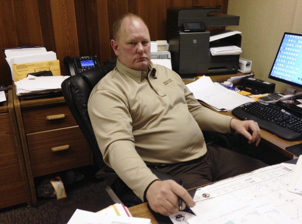 Morton County Sheriff Kyle Kirchmeier at his desk in Mandan, N.D. (AP Photo/James MacPherson)
