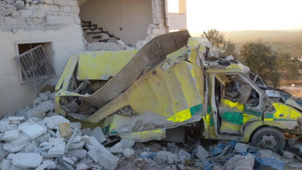This photo provided by the Shafak Charity Organization, which has been authenticated based on its contents and other AP reporting, shows an ambulance destroyed following four consecutive airstrikes on a medical facility dedicated to women in the northern Idlib province, Syria, Friday, Nov. 25, 2016. The airstrikes knocked the facility out of service and killed two civilians. Shelling in the northern city of Aleppo also knocked out another gynecology hospital Friday, badly damaging it. (Shafak Charity Organization via AP)