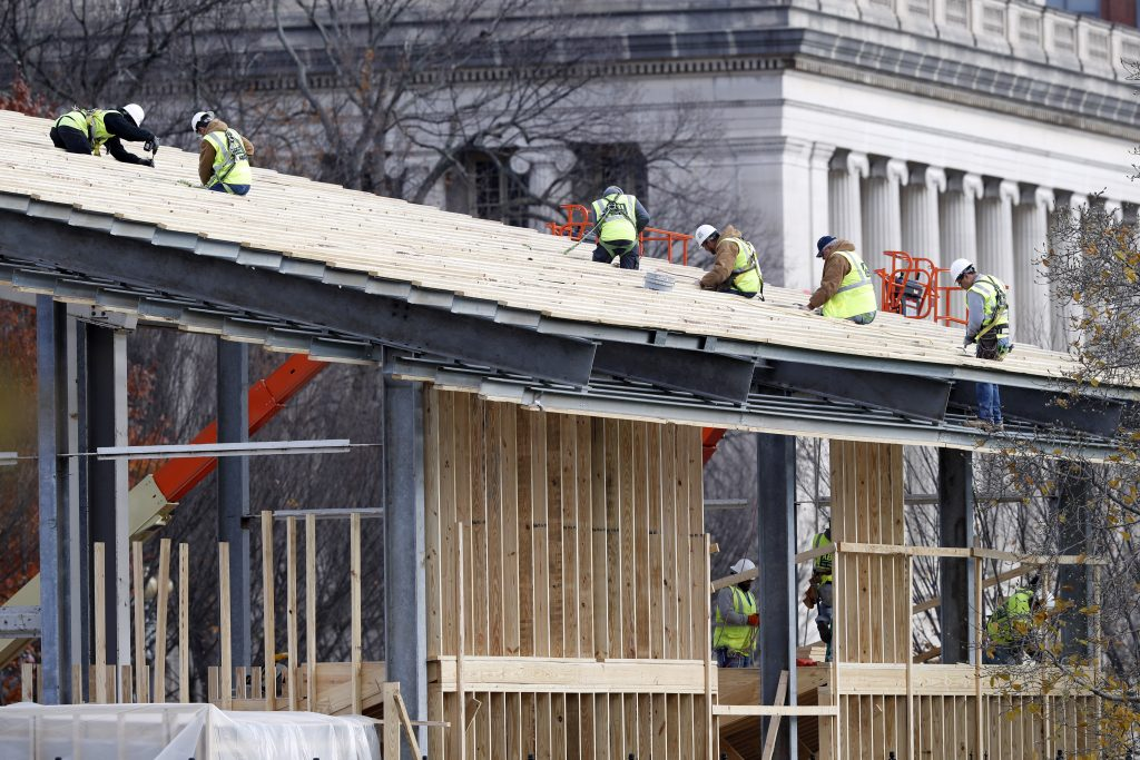 Construction continues on the presidential reviewing stand on Pennsylvania Avenue in front of the White House in Washington DC. (AP Photo/Alex Brandon)