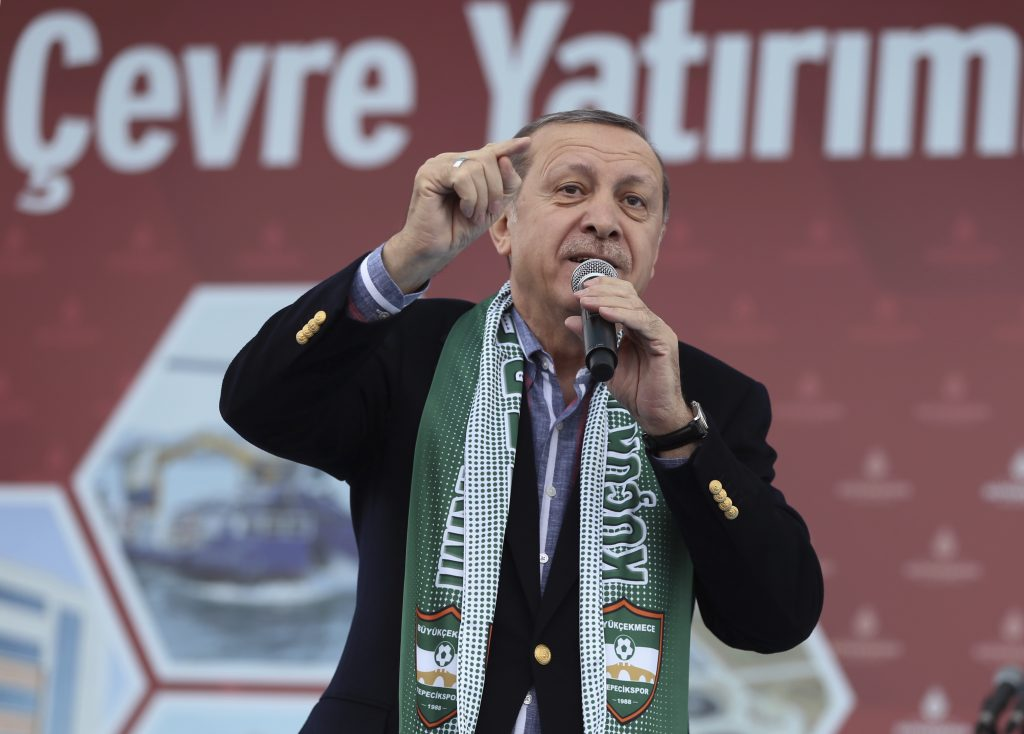 Turkey's President Recep Tayyip Erdogan addresses his supporters in Istanbul, Saturday, Nov. 26, 2016. Erdogan on Friday accused the European Union of dishonesty and betrayal, and threatened to remove controls from his country's borders, flooding Europe with hundreds of thousands of asylum-seekers and other migrants.(Murat Cetinmuhurdar/Presidential Press Service, Pool photo via AP)