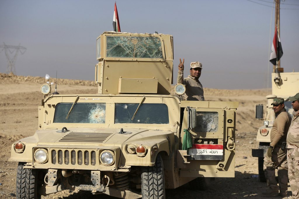 Iraqi Army soldiers deploy at a recently liberated village outside Mosul on Tuesday. (AP Photo/Hadi Mizban)