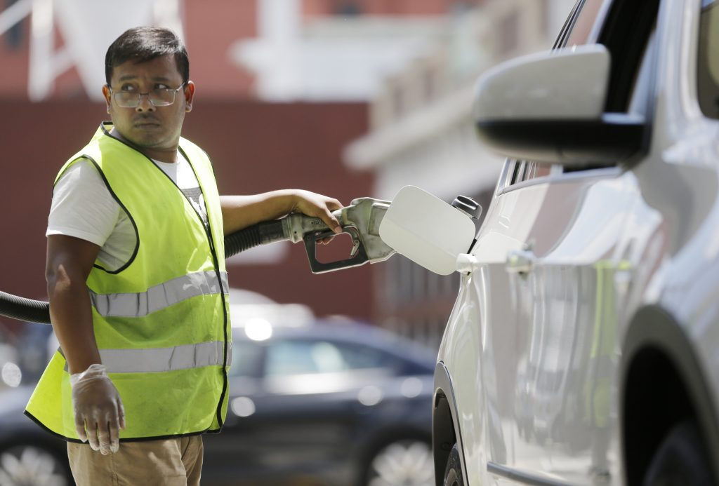 An attendant pumps gas at a BP gas station in Hoboken, N.J.  (AP Photo/Julio Cortez)