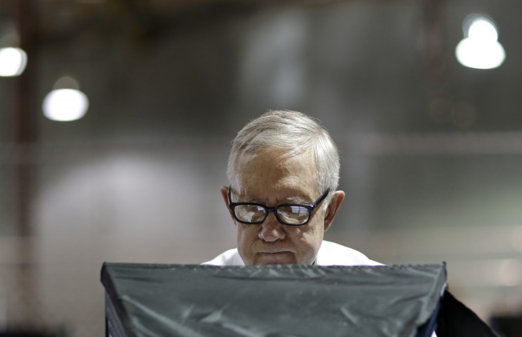 Senate Minority Leader Harry Reid of Nev. votes at an early-voting site in Las Vegas on Wednesday. (AP Photo/John Locher)