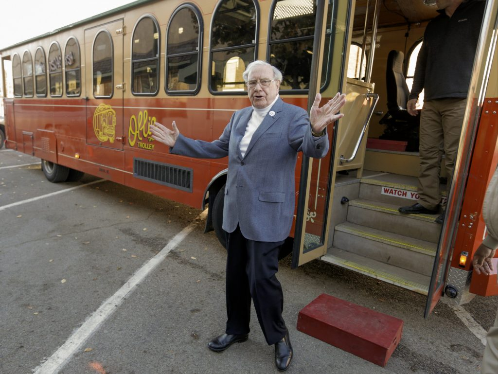 Warren Buffett arrives rented a trolley to take voters to their polling station, on Election Day in Omaha, Neb. (AP Photo/Nati Harnik)