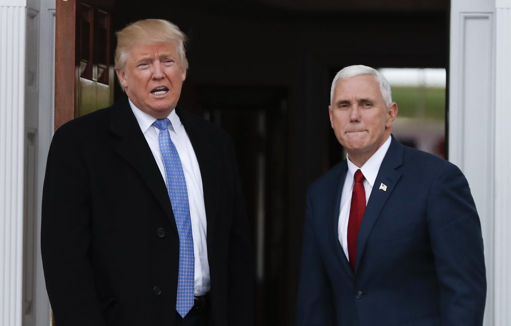President-elect Donald Trump (L) and Vice President-elect Mike Pence at the Trump National Golf Club Bedminster clubhouse, in Bedminster, N.J. (AP Photo/Carolyn Kaster)