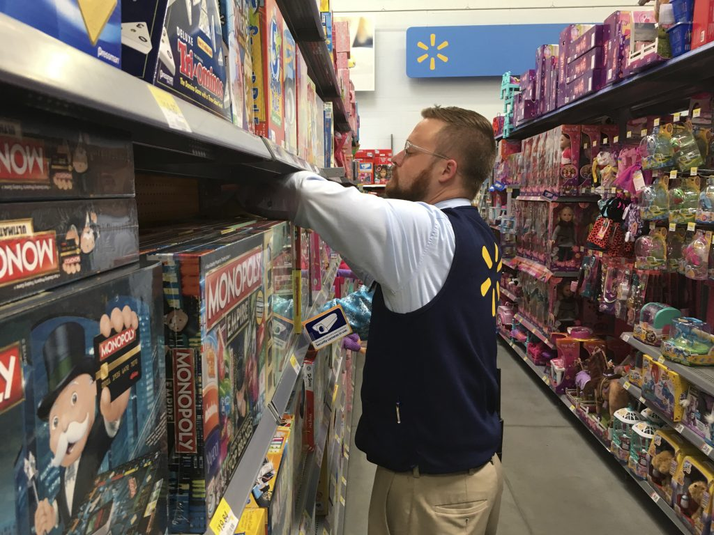 A Wal-Mart employee in Denver stocks toys on shelves on Wednesday, , to prepare for the Thanksgiving night rush. (AP Photo/Jim Anderson)