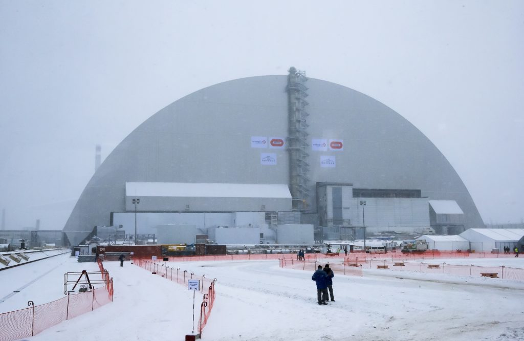 Workers inspect the New Safe Confinement (NSC) movable enclosure at the nuclear power plant in Chernobyl, Ukraine, Tuesday. (AP Photo/Efrem Lukatsky)