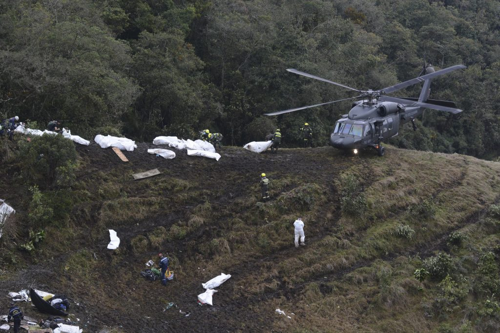 Rescue workers place the bodies of victims of the plane crash into a waiting helicopter, in La Union, near Medellin, Colombia, on Tuesday. (AP Photo/Luis Benavides)