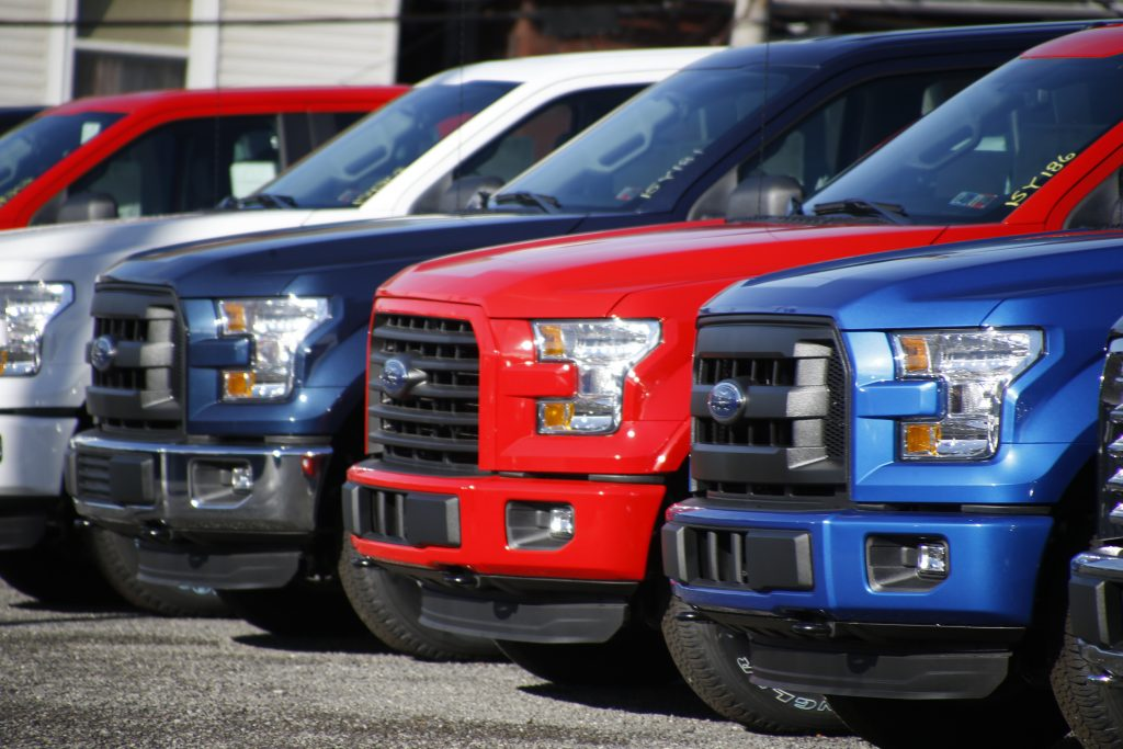 Ford F-150 pickup trucks on the sales lot at Butler County Ford in Butler, Pa. (AP Photo/Keith Srakocic)