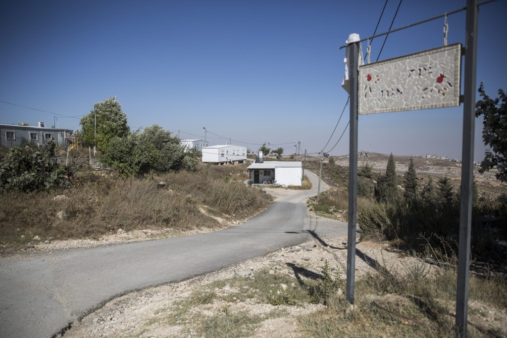 View of a street and caravan homes at the Amona outpost in the Mateh Binyamin Regional Council. (Hadas Parush/Flash90)