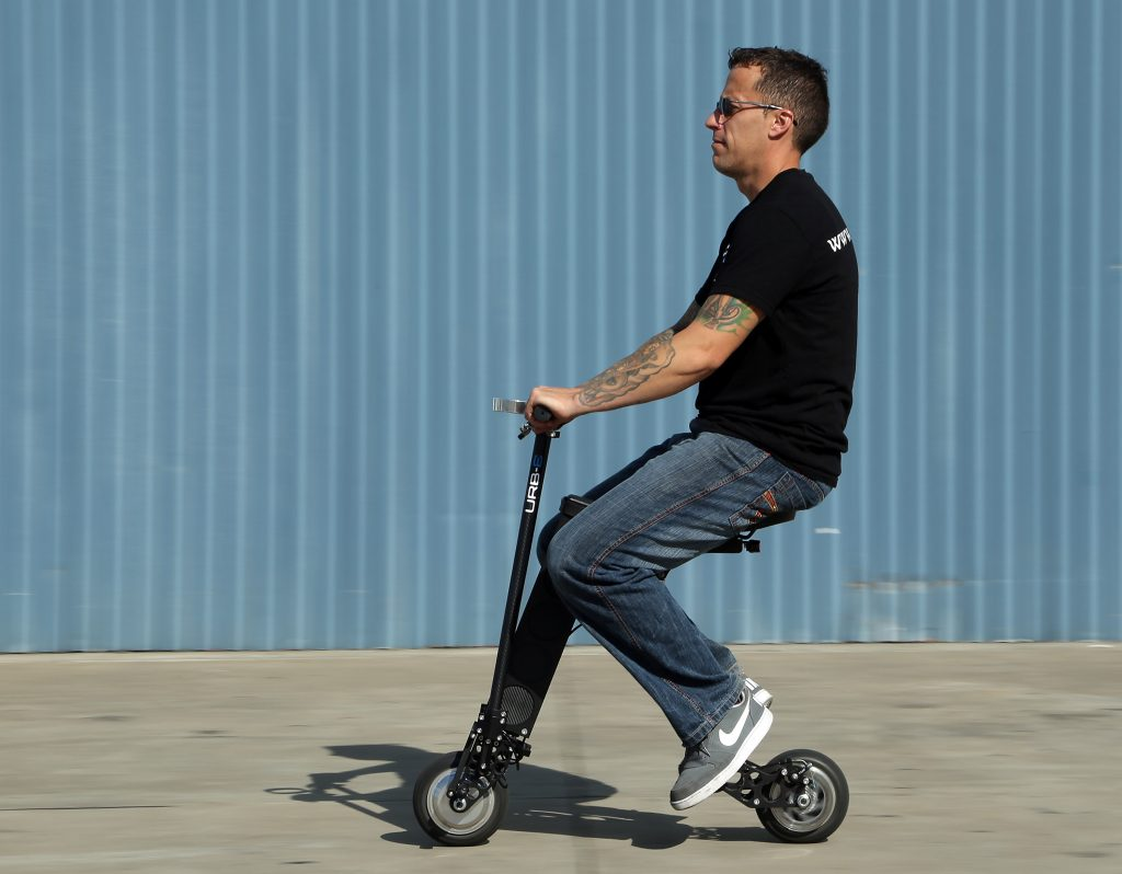 Casey Day demonstrates an URB-E personal scooter. (Myung J. Chun/Los Angeles Times/TNS)