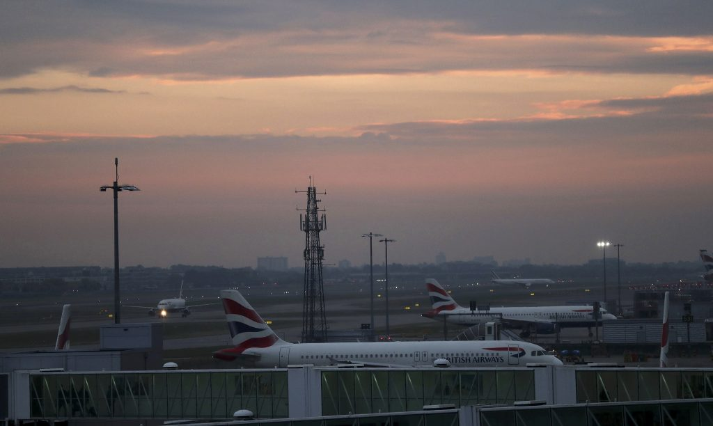 Aircraft taxi in the early morning at Heathrow airport in west London, Britain October 25, 2016. REUTERS/Eddie Keogh