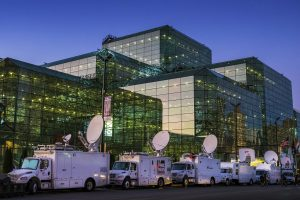 Satellite trucks line up outside of the Jacob Javits Center in New York, late Sunday evening, Nov. 6, 2016, as preparations continue inside for Democratic presidential nominee Hillary Clinton's election night rally Tuesday. (AP Photo/J. David Ake)
