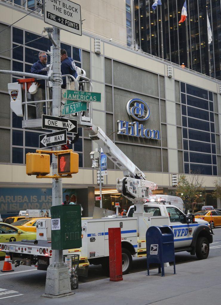 NYPD install police security camera near the Hilton hotel in New York, Friday Nov. 4, 2016, where Donald Trump organizers will gather on election night. (AP Photo/Bebeto Matthews)